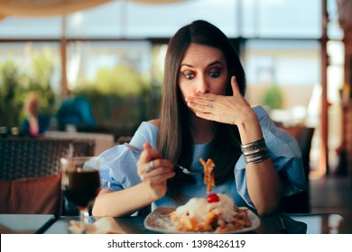 Woman Feeling Sick While Eating Huge Meal. Person experiencing overeating side effects at lunch