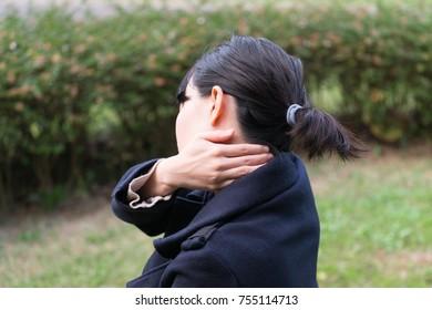 Woman feeling stiff shoulder