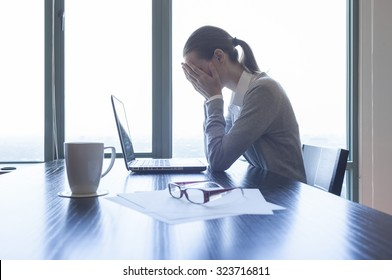 Woman feeling stress from work.
