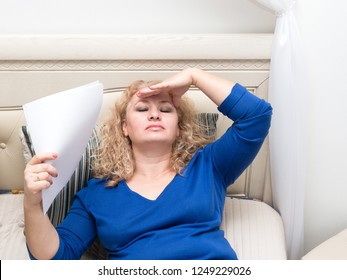 A woman feels bad because of menopause. Hot flashes, sweating, dizziness, irritability. Menopause concept. Harmonious restructuring of the body.