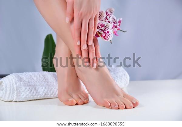 woman-feet-hands-natural-polish-600w-166