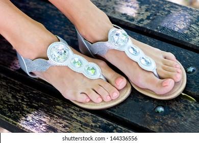 woman feet in modern summer sandals