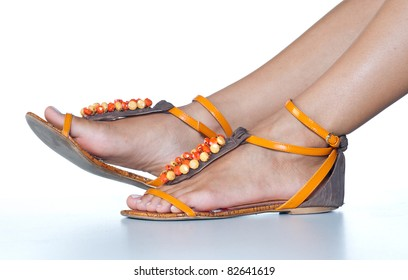 woman feet in summer sandals shoes