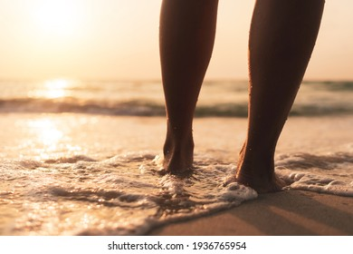 Woman feet walk slow life and relax on sand tropical beach with blue sky background.