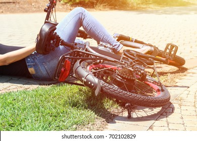 A woman fell with her bicycle in the park