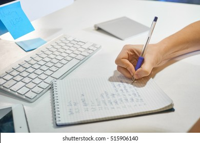 Woman female hands with pen writing on notebook at home or office