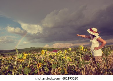 Woman in field with sunflower