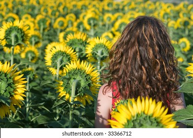 Woman in the field of sunflowers