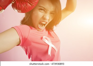 Woman fight. Pink ribbon in support of October, breast cancer awareness month.