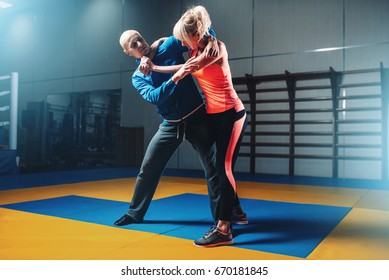 Woman fights with man on self-defense training