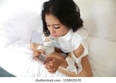 woman filipino using smartphone from top view.