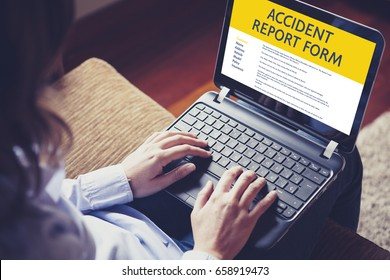 Woman fill in an accident report form with a laptop by internet.