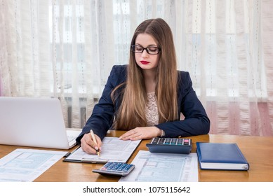 Woman filling 1040 form, work in office
