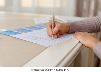 Woman filling up form in clinic