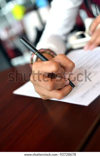 Woman filling the form on job interview