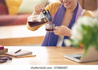 Woman filling her cup with fresh coffee