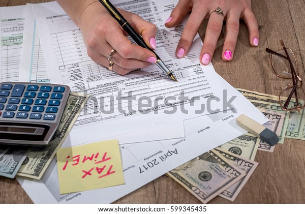 woman filling tax forms. 2017