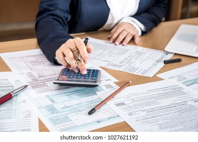 Woman filling US 1040 tax form 2018 year