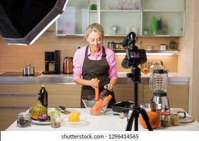 Woman filming cooking vlog. Concept of vlogging, blogging and content creation.
