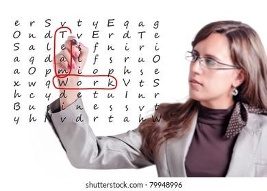 Woman finds on a whiteboard crosswords a few key points of Teamwork