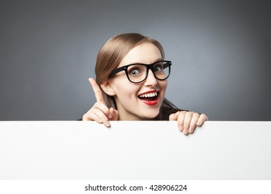 woman with finger up looking at camera