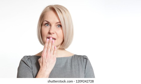 Woman with finger on lips, or secret gesture hand sign  isolated on white background