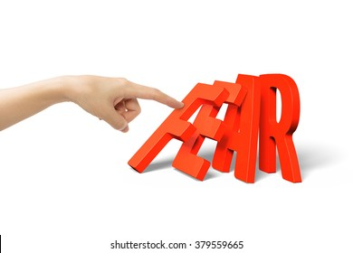 Woman finger pushing domino of red fear word falling, isolated on white.