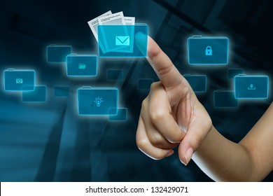 a woman finger in selection a folder on a digital screen