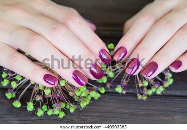 Woman fingernails with cat eye pink manicure