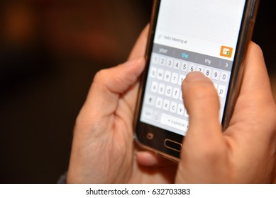woman fingers writing a message on mobile phone