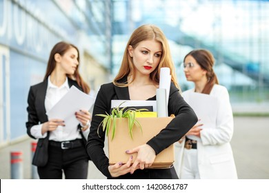 The woman was fired from the corporation. The end of a career. Concept for business, unemployment, labor exchange and dismissal.