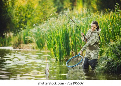 woman fishes on the river. Spinning equipment, angling, fisherwoman concept.