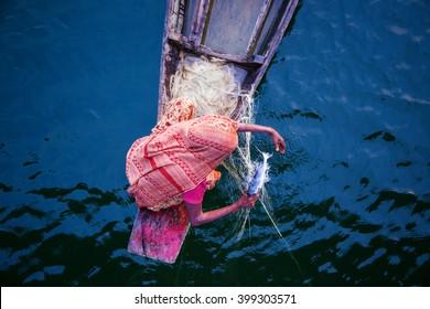 Woman fishing, Bangladesh