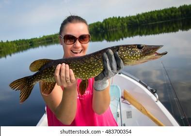 Woman fishing pike