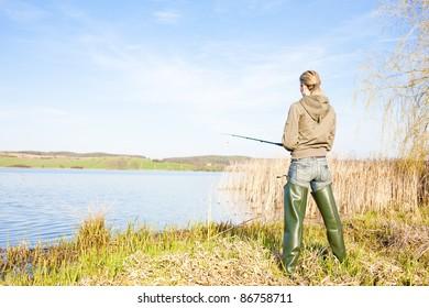 woman fishing at a pond