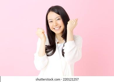 Woman fist pumped celebrating success