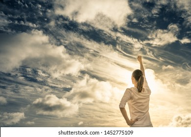 Woman with fist up to the sky.