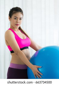 Woman with fit ball in fitness gym or yoga class. Healthy lifestyle concept.