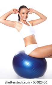 Woman with fitness ball doing some abs Exercises