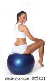 Woman with fitness ball doing some  Exercises