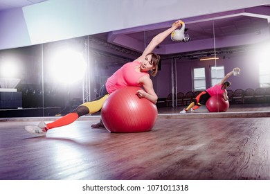 a woman with fitness equipment by fitness exercise in the gym room