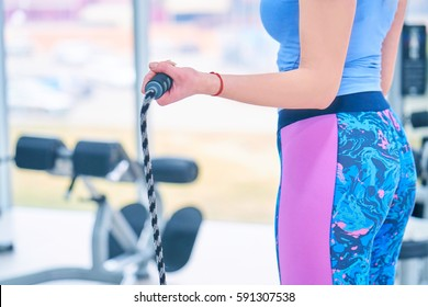 Woman at the fitness gym with a pilates ball