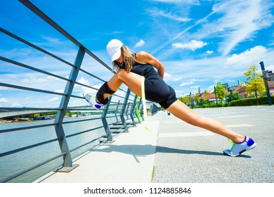 woman fitness instructor doing training outdoor summer day city promenade along river
