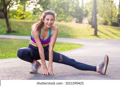 Woman fitness outdoor concept, young caucasian beautiful woman/sport girl running walking stretching and yoga at outdoor park with fresh, relax, happy feeling.