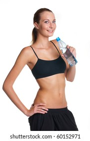 Woman in fitness pose holding water bottle