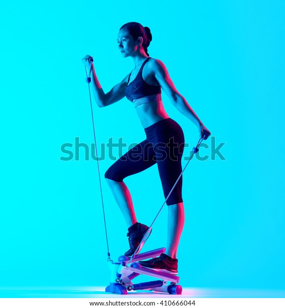 woman fitness Stepper exercices isolated