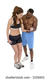 Woman in fitness workout clothing is getting help from a male personal trainer in using hand weights.  Isolated shot on white.
