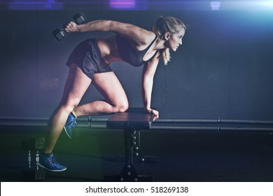 woman fitness workout - holding dumbbells