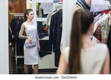woman in fitting room at a clothing store
