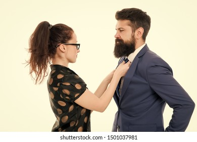 woman fix her man bowtie. formal business couple. business with personal assistant. elegant sexy woman fixing her lovers bowtie. Preparation for party. corporate party in office. mr perfection.